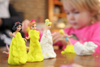 baby playing with her disney toys