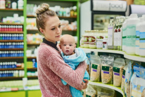 mother shopping with her baby at the store