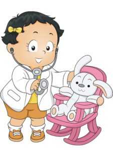 baby girl playing doctor with plush animal in pink chair