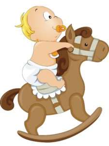 baby with pacifer on rocking horse