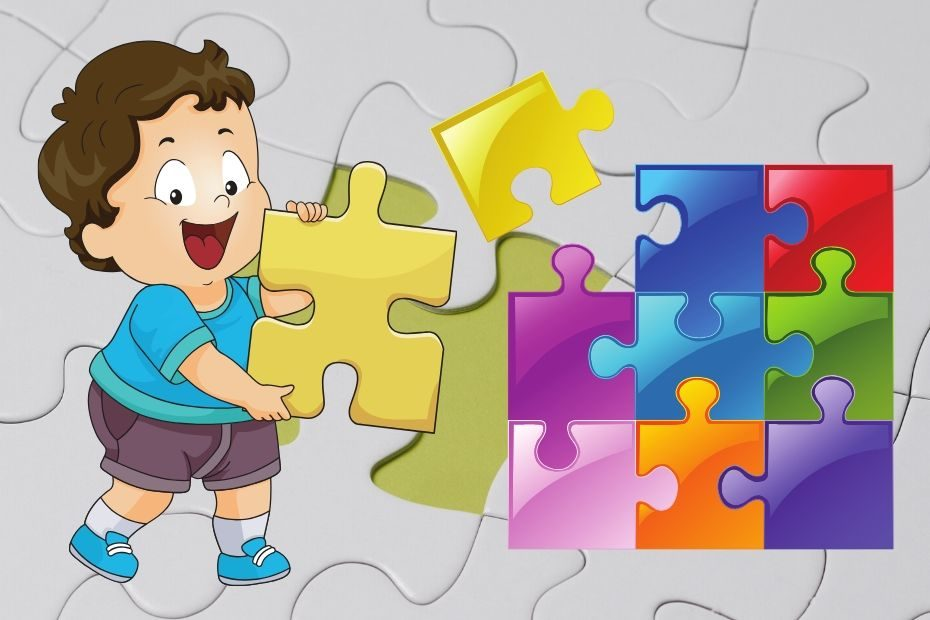 toddler holding yellow puzzle piece